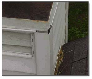 Old chimney chase pan allows siding to protrude outside of chase edge